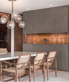 """""""Oscar dining chairs designed by Sergio Rodrigues featured in project. Dining Cabinet, Cabinet Decor, Condo Design, Home Interior Design, Modern Kitchen Ovens, Living Room Designs, Living Room Decor, Dining Room Chairs, Home Renovation"""
