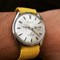 One of the rarest Grand Seikos! Manufactured in 1967 one of the wonders of this watch is the 39 Jewels and slow frequency (19,800bph). Model number 6246-9001. Sporting a 20mm @nixawatchband Pineapple Yellow Perlon band.