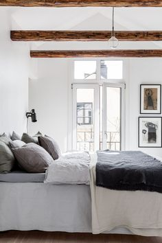Layers of Linen, art, white, French doors, sunshine. Bedroom