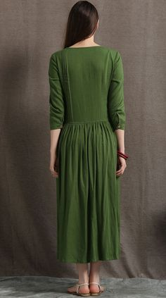 This moss green linen dress is a lovely summer basic that can be worn from day to night. Pair it with statement jewellery and simple shoes for an