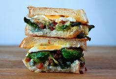 brussels sprout, gorgonzola, gruyere, and pancetta grilled cheese with a sunny side up egg.