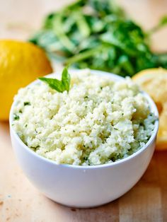 Lemon Garlic Cauliflower Rice. A healthy substitute for rice! It's naturally gluten free, vegetarian (can be vegan!), and so tasty! Full of fresh lemon juice, basil, garlic, and parmesan cheese. Less than 300 calories for the WHOLE recipe! showmetheyummy.com #glutenfree #healthy #vegetarian #vegan #lightenedup #cauliflower #fresh #rice