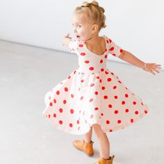 Soft and twirly play dress with a low scoop back, elbow sleeve, and circle skirt. 95% cotton 5% lycra made in usa