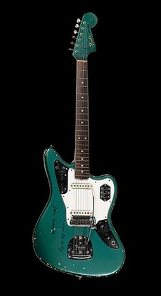 "John Frusciante's 66 Fender Jaguar, from the ""Under the bridge"" video. At the Hard Rock Cafe in Caracas, Venezuela. Check the entire gallery: http://www.premierguitar.com/Magazine/Issue/2013/Apr/GALLERY_Hard_Rock_Collections_Iconic_Axes_Part_2.aspx"