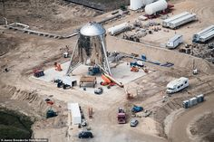 Space Frontier Elon Musk's Starhopper gleams on the launchpad in stunning aerial photos ahead of its first test hop