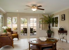elegant-patio-rooms-design-ideas-plus-ceiling-fans-with-lights-with-wood-furniture-also-iron-console-table