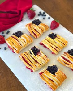 An easy and tasty dessert for your favorite holiday: Patriotic Puff Pastry Flags made with fresh strawberries and blueberries. Puff Pastry Dough, Frozen Puff Pastry, Delicious Desserts, Yummy Food, Patriotic Desserts, Unique Recipes, Amazing Recipes, Pastry Recipes, Holiday Recipes