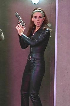 7. Both Elizabeth Hurley's and Mimi Rogers' catsuits were modeled after the one worn by the character Emma Peel (center) from the British TV series The Avengers.