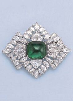 A FINE ART DECO EMERALD AND DIAMOND BROOCH, BY BOUCHERON. Of openwork design… #DiamondBrooches
