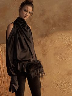 The cold shoulder never goes out of style... Re-invented for fall in luxurious silk