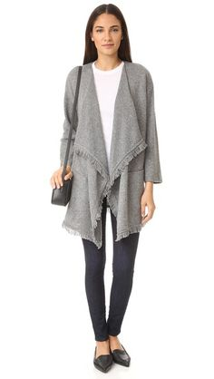 Texture-rich marled knit lends dimension to this relaxed Soft Joie cardigan. Short fringe trims the edges. Open placket. Welt hip pockets. Long sleeves.