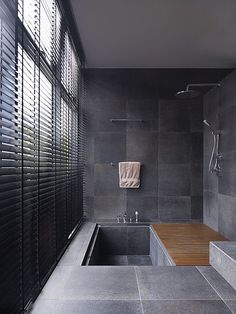 Sunken bath tub, natural stone flooring, dark grey tiles - this bathroom is somewhere we'd love to have a long soak in! Contemporary Bathroom Designs, Modern Bathroom, Japanese Bathroom, Master Bathroom, Slate Bathroom, Modern Shower, Masculine Bathroom, Bathroom Wall, Contemporary Bathtubs