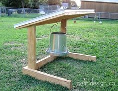 My husband built this to keep the rain off the chicken feed blogged