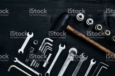 Flat lay of set of tools for car repairing such as wrenches on black wooden background. Top view royalty-free stock photo