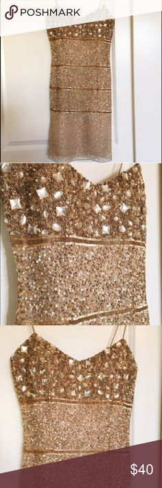 Aidan Mattox Gold Embellished Dress This dress is beautiful! I'm reposhing because i found another NYE dress to wear. The price is due to the straps. They just need some repurposing but they are still in tact! Perfect for New Years Eve Aidan Mattox Dresses