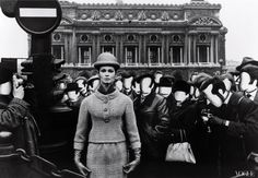 """With a surrealistic flourish, William Klein photographed Marie-Lise Grès among a swarm of faceless onlookers in front of the Paris Opera, 1963. Klein was """"very good-looking, easy to work with, but completely selfish,"""" editor Babs Simpson recalls."""