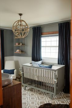 Sophisticated Modern Nautical Nursery with the white leather Joya Rocker by Monte Design