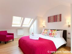This bright bedroom is part of a #vacation #rental in #London. What do you think of the bold colors?