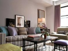 green and purple accents for living room decorating in neutral colors