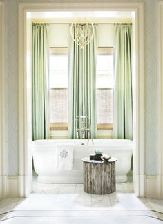 Love the tall curtains. wall color and curtain color are perfect, blue and green.  Wall cover curtain idea: use thick white/cream curtains between the color curtains
