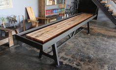 Shuffleboard table made from reclaimed oak, leather & steel.