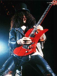 Slash and his BC Rich Mockingbird guitar. (Via: http://members.tripod.com ) great pic; ha? ;D