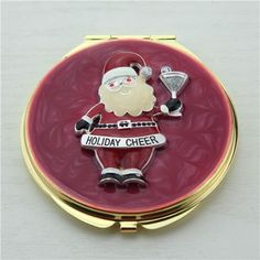Santa Claus compact mirror  It is covered with red enamel glaze and mounted with bling-bling crystals. There are two mirrors inside.