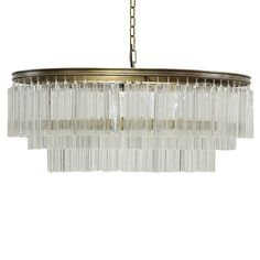 The Oval Deco Chandelier by Noir emphasizes natural, simple and classic design. Noir has been designing, building and importing a very unique, but ever growing collection of home furnishings for more than 10 years.  <i>Noir products are hand finished and created with a concentrated effort toward environmental sustainability. Variations could occur and are not considered as product defects.</i>  Material: Glass & Metal  Finish: Antique Brass   Includes 6 feet of chain and cord. Includ...