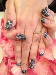 Grey polish with black and white one stroke freehand flower nail art