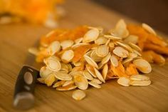 """Nothing says Halloween quite like the glowing pumpkins on every doorstep. But what happens to all those """"guts"""" once you've scooped them out of your Jack O'Lantern? Our friends at Green Halloween share this easy recipe for roasted pumpkin seeds – a great tasting and healthy snack. Pumpkin seeds provide our bodies with zinc which is perfect at this time of year to help ward off colds. Green Halloween suggests trying different combinations of flavors."""