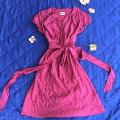 Converse One Star Pink Dress Converse One Star dress. Extra long tie that can be worn in the front, to the side, or in the back. The material is meant to look wrinkled. Like new condition. Inspected for rips, stains and odors. Converse Dresses Midi
