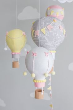 Hot air balloon baby mobile. Pink, grey and yellow nursery décor with a cute elephant for a travel theme nursery.  A whimsical addition to your