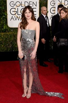 Dakota Johnson shined in a silver dress from Chanel Haute Couture at the 2015 GOLDEN GLOBE AWARDS