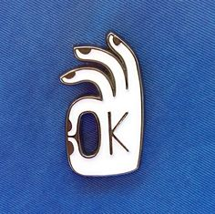 lapel pin of my original OK drawing second edition white & silver 30 x 16.5mm