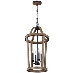 """Rustic French Lantern - Medium. This distinguished fixture merges a period-inspired French lantern silhouette with a warm weathered wood finish and weathered zinc hardware for a transitional piece that borrows from rustic and French antique themes. Available in three sizes. 4x60 watt candle base max. (30.5""""Hx15""""W). Supplied with 180'' of wire. Supplied with 60'' of chain. Canopy (1""""Hx5.5""""W). OAH 92''."""