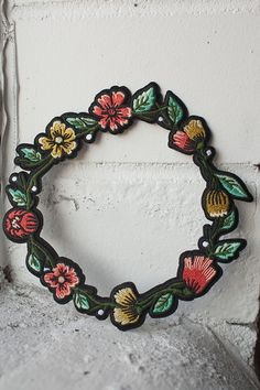 "Embroidered floral wreath with iron-on backing can be used to frame and complement your other favourite patches - perfect on the back of a jacket! Coming in at just under 6.5"" circumference, the wreat"