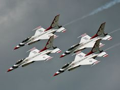 A tight formation of four Thunderbirds F-16C Fighting Falcons.