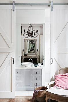 White sliding barn doors feel modern and glam