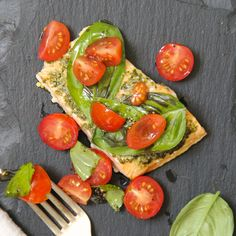 Cherry tomatoes add a gentle sweetness and acidity to this herb-heavy baked salmon.