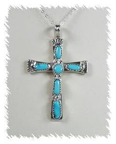 The famed Zuni Iule family continues to make classic sterling silver and turquoise crosses.