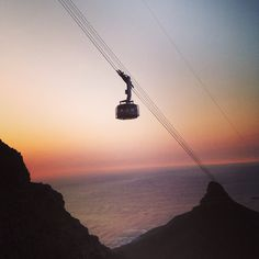 Cableway at sunset. Table Mountain, Cape Town, Track Lighting, Black Shoes, South Africa, This Is Us, African, Ceiling Lights, Sunset