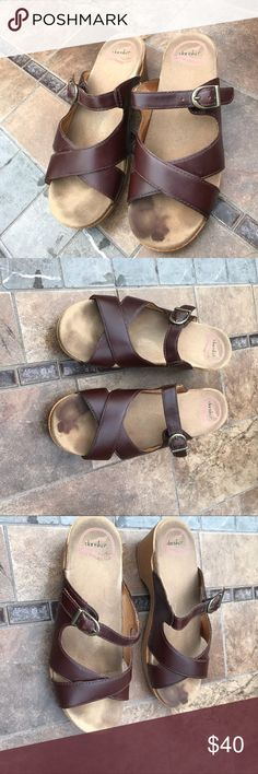 Dansko  Seal Brown Leather Slide Sandals Dansko  Seal Brown Leather Slide Sandals With Strappy wedge buckle with tan faux wood platform. Size Euro 38. Left toe bed stain , I tried to clean. The rest of Shoes are in very good condition. No wear to heels. Dansko Shoes Platforms