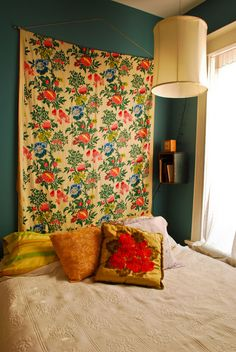 Try a beautiful quilt or tapestry above the bed instead of a headboard to give your space a unique look!