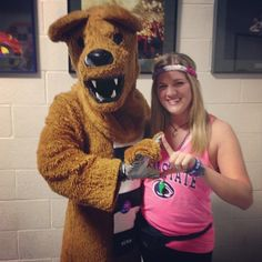 The Lion throws up diamonds with a THON dancer.