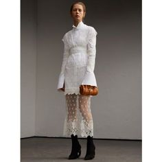 A long-sleeved panelled dress crafted from ornate embroidered tulle, and framed by decorative scalloped trims. A high-waist panel is precisely placed for a flattering, feminine silhouette. The design is fixed to a fitted cotton shirt dress, detailed with a wing collar and double cuffs