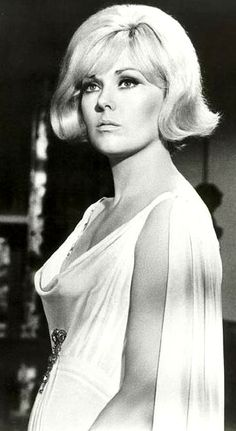 Kim Novak was born with the birth name of Marilyn Pauline Novak. She was the daughter of Joseph Novak, a former teacher turned transit clerk and his wife, Blanche Kral Novak, also a former teacher. Throughout elementary and high school, Kim did not get along well with teachers... https://en.wikipedia.org/wiki/Kim_Novak AND ALSO http://www.kimnovakartist.com/