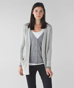 Release Date: 8/2014. Original Price: $138. Materials: Boolux. Color: heathered medium grey / heathered angel wing. Why we made this  Who says you have to choose? This sweater combines a vest and a cardigan to be the best of both worlds. A combination of super-soft and breathable fabrics give us room to cool off after class and the long length is easy to layer over our tights. When it comes to post-practice comfort, this vestigan has us covered.Key features  cotton yarn cardigan is ...
