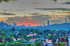 A sunset scene over the city of Johannesburg, South Africa. My Land, City Photography, Beautiful Sunset, South Africa, Screen Printing, Great Gifts, Places To Visit