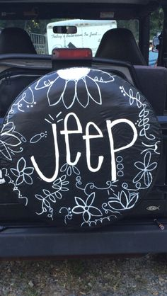 Homemade jeep tire cover!  All you need is paint pens and paint sealer