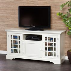 This contemporary media stand has many compartments to store your DVD collection. It has a beautiful off-white finish that will brighten your living room. The tempered glass cabinet doors are sturdy and allow you to view stored items.